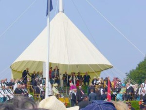 Tynwald Hill with a canopy and slew of dignitaries.