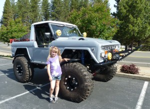 "Miss Sophie with her '72 Ford Bronco rock-crawler, a classic case of ""Beauty and the Beast."""