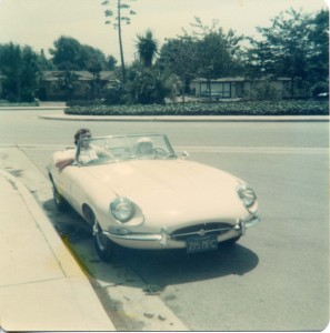 "My niece sitting in my '67 Jag XKE.  That car had a ""WOW"" factor that was off the charts."