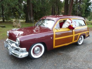 Here Comes Santa Claus, in a '51 Ford Woodie!