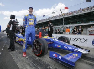 Alexander Rossi stands by his car during qualifications for the Indianapolis 500 auto race at Indianapolis Motor Speedway in Indianapolis, Sunday, May 22, 2016. (AP Photo/Darron Cummings)